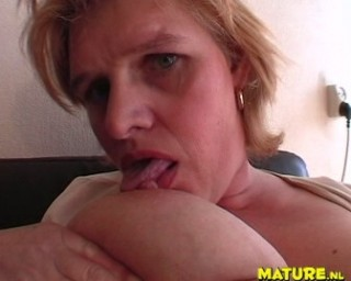 Hot blonde mature playing with her pussy