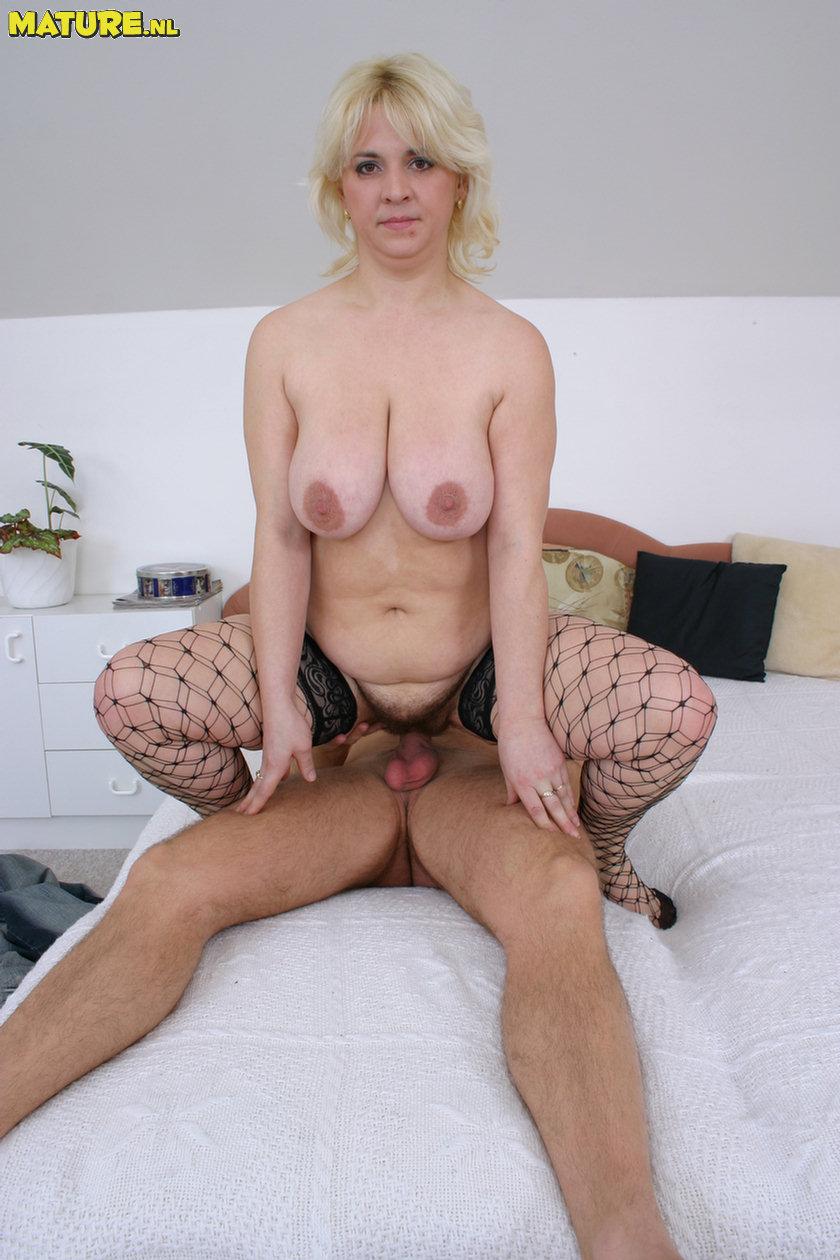 Horny blonde mature