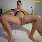 Sleazy mature slut playing with herself