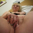 Blonde mature whore showing her cunt and tits