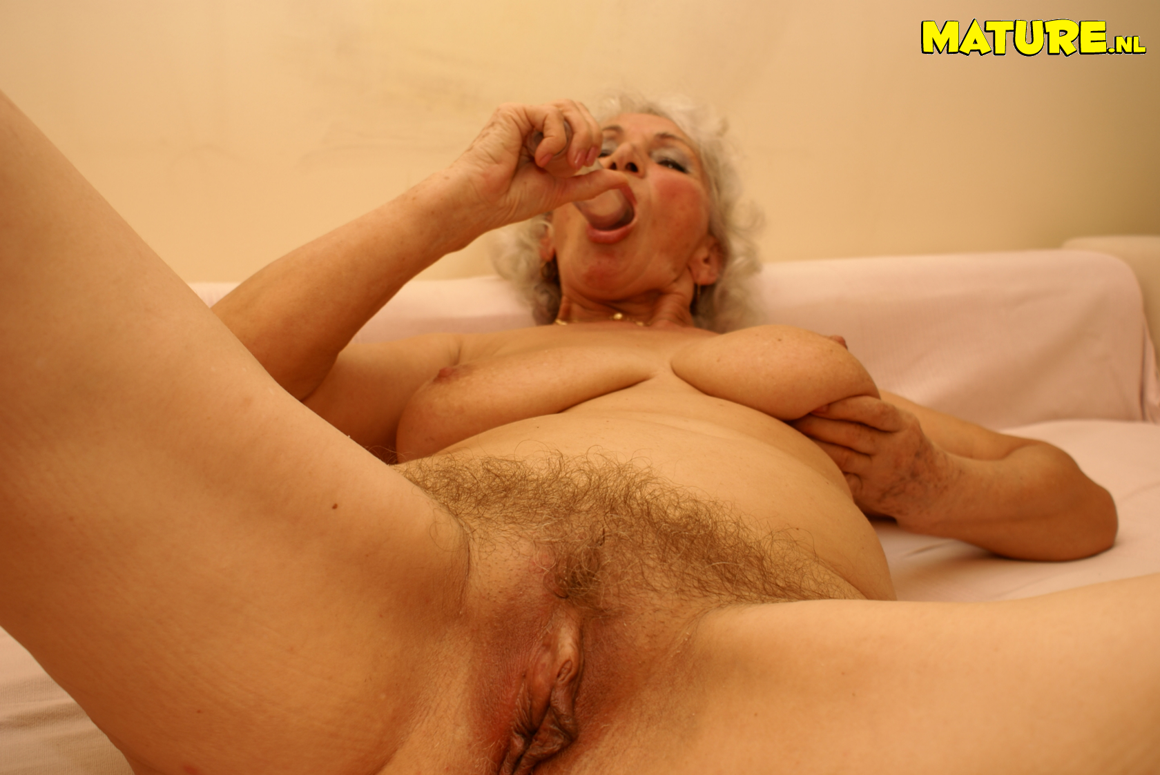 grandma loves playing with her wet pussy