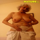 This grandma loves playing with her wet pussy