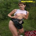 Mature slut fucking in an open field