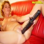 Mature slut playing on her sofa