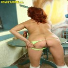 hot redhead mature rides the cock