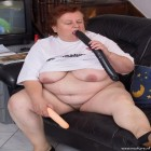 Chubby mature slut playing with a toy on her couch