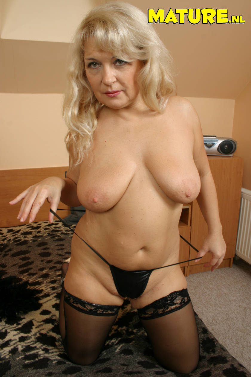 Mature huge tit women having sex