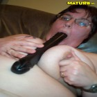 fat ass mature shoving everything up her love hole