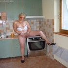 Horny housewife naked in the kitchen