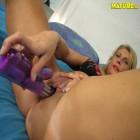 Blonde mature nympho enjoying her toys