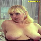 This old blonde slut plays with herself
