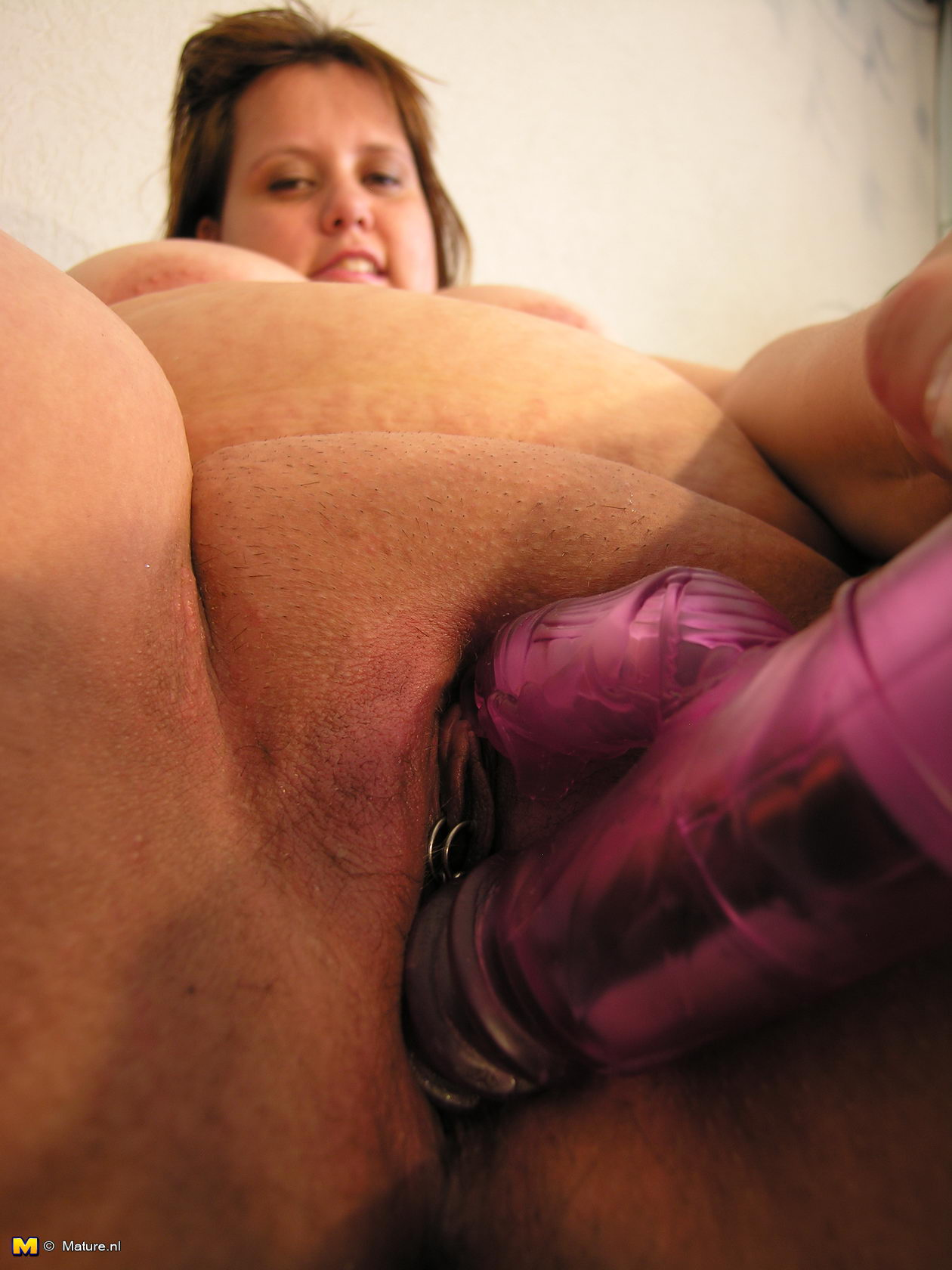 Mature woman playing with dildo before sleep