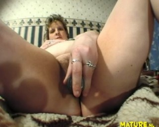 See this big mature play with herself