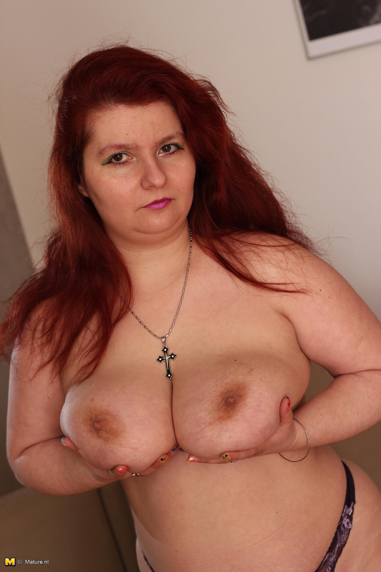 image Big titted mature gets fucked while smoking