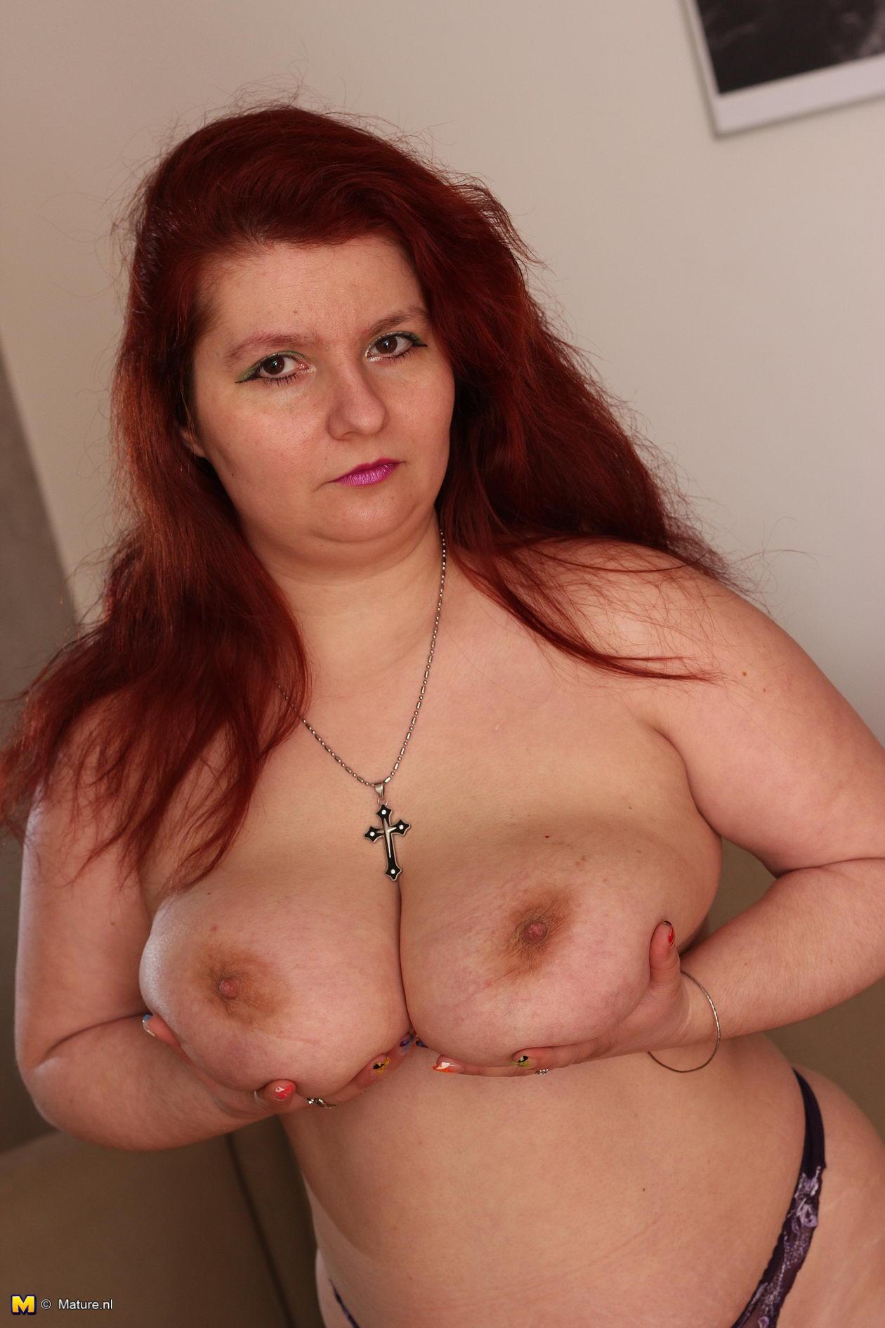 Big breasted mature slut going wild 1
