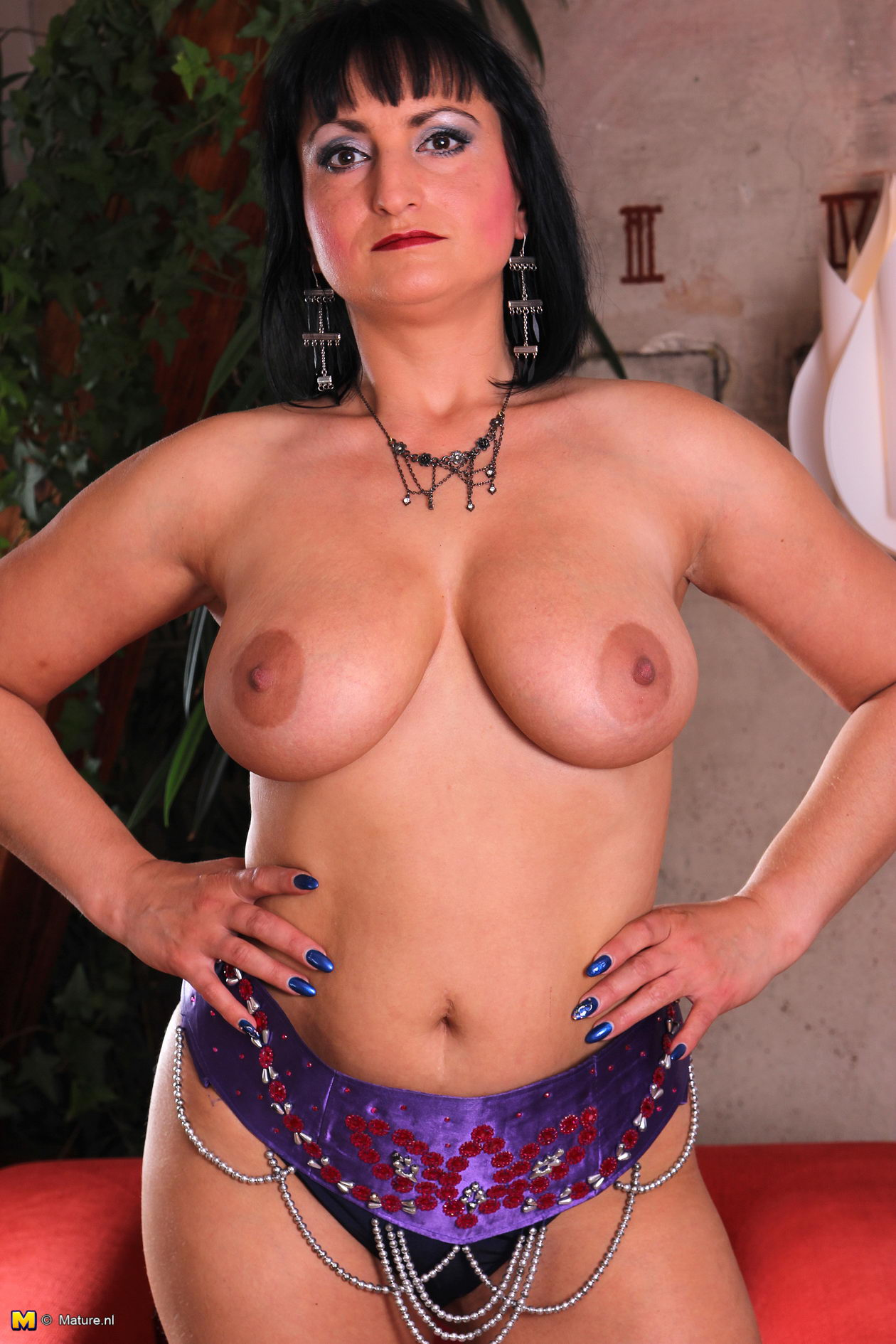 image Dark haired milf with 2 mandingos