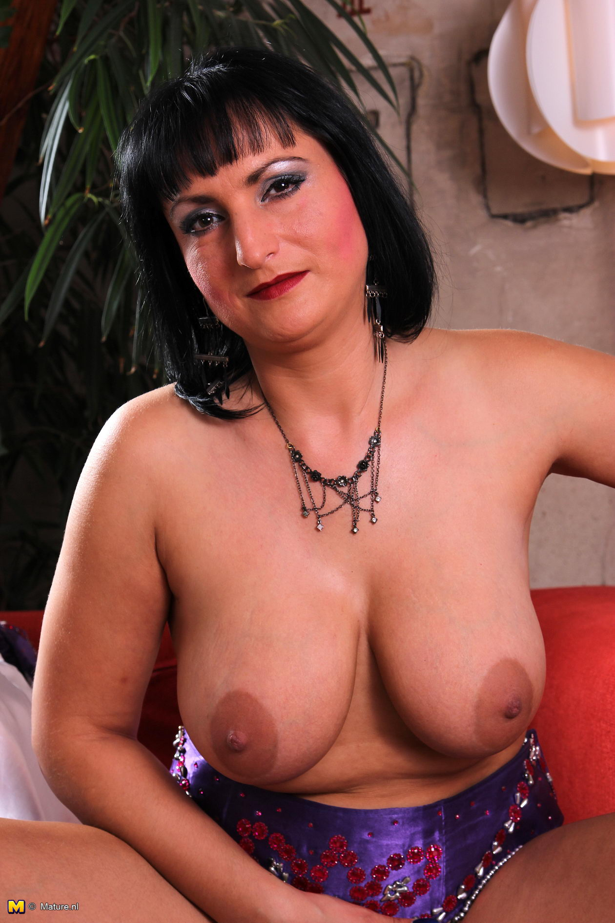 Blonde MILF in Stockings Shows off Her Lovely Big Tits