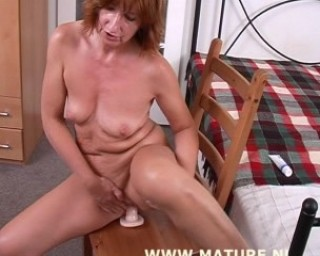 spreading her mature pussy