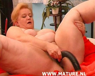 This chubby mature slut loves to play with herself