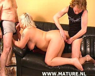 This chubby mature slut loves two cocks at the same time