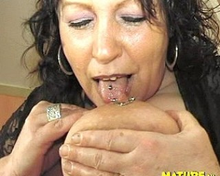 Big titted housewife playing with toys and a cock