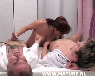 Two guys are having fun with one mature cunt