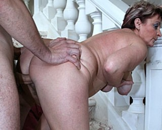 This mature slut gets fucked on the stairway