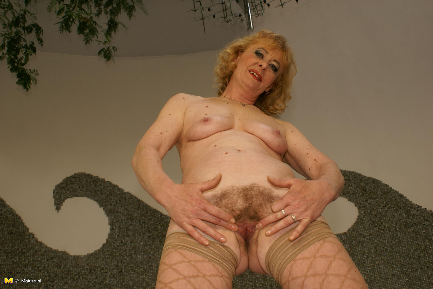 Mature hairy pussy by the pool