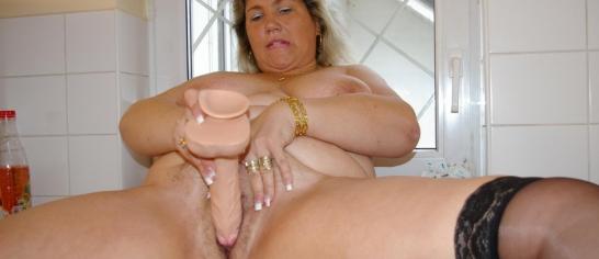 image Big tittied mature with glasses masturbates