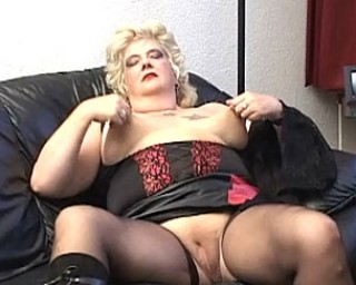 Horny blonde plumper playing with herself on the couch