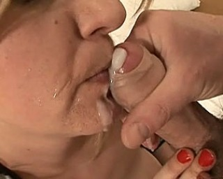 Deep fisting and cum licking mature whore in action