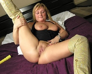 Horny housewife playing with herself on bed